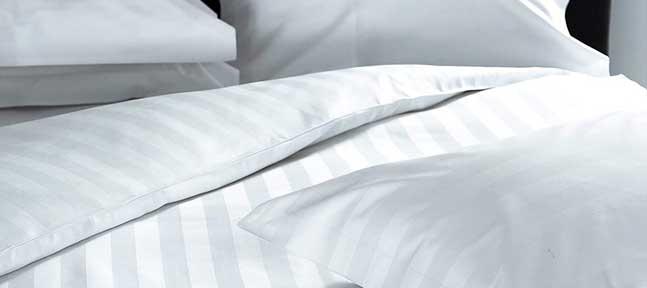Что для отеля выгоднее, дешевое или дорогое постельное белье, и почему